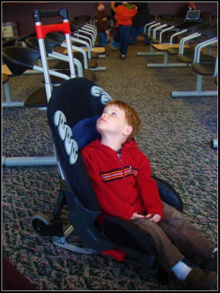 rolling car seat for use in airport