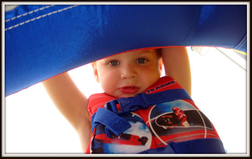 Rhett looking out from under blue sail