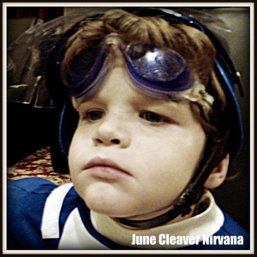 Rhett wearing goggles, SWAT helmet and power ranger suit