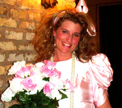 Holly as an 80s bridesmaid