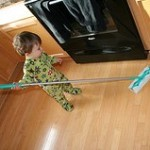 toddler sweeping the floor