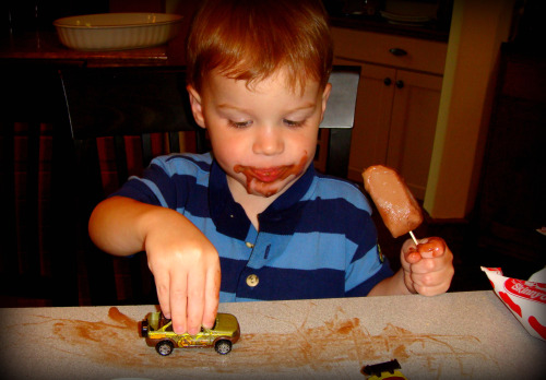 Rhett driving cars in his popsicle mess