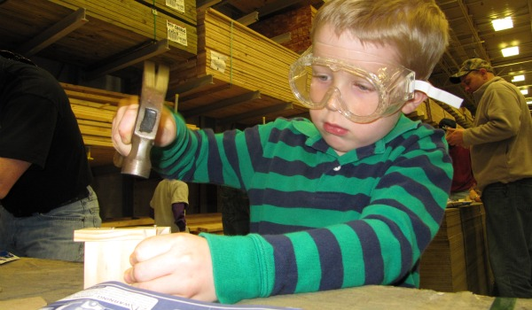 Boy with goggles and hammer