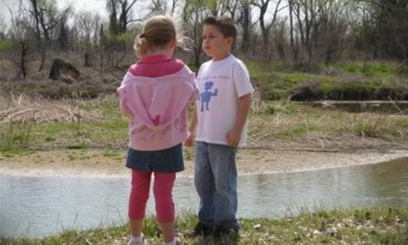 girl and boy at creek