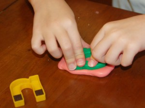 preschooler learning letters with goop