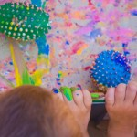preschoolers painting with balls