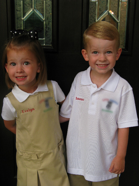 2 children posed in school uniforms