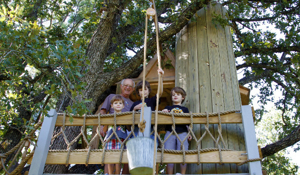 tree house with tower that leads to second floor