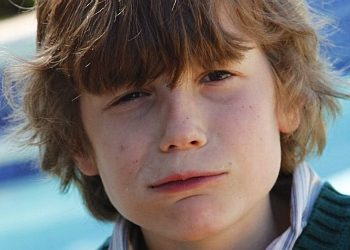 boy of 9 exaggerates and looks uncertain