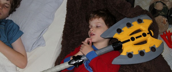 Nerf battle axe clutched in sleeping boys hands
