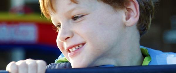 boy smiles and wants name change