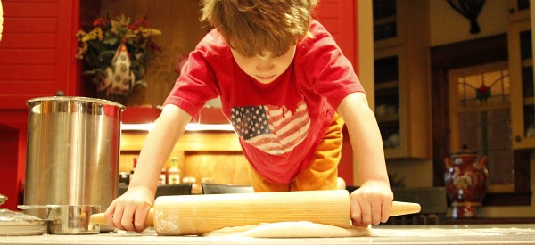 Boy Rolling Out Cinnamon Roll Dough