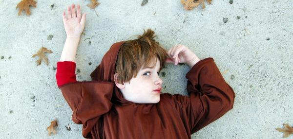 boy dressed in monk costume