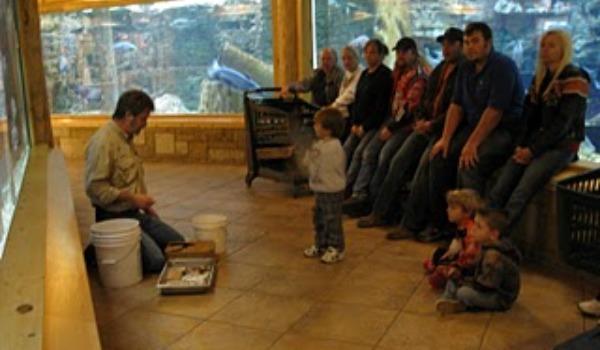 kids listening to man talking