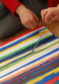 Preschoolers Painting Stripes with Painters tape