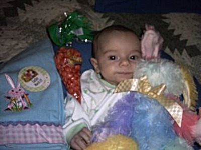 baby with Easter goodies 400x300