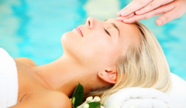 woman getting relaxing facial or massage on face
