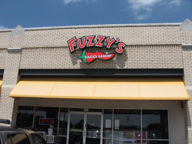 Fuzzys Taco Shop sign front door
