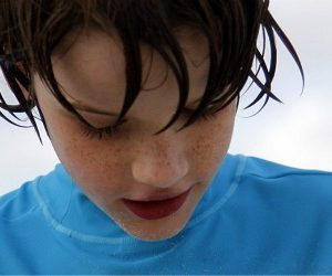 boy with sand on face