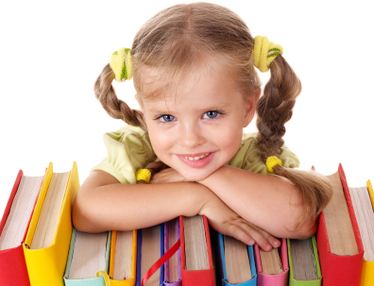 cute young girl leaning on colorful books