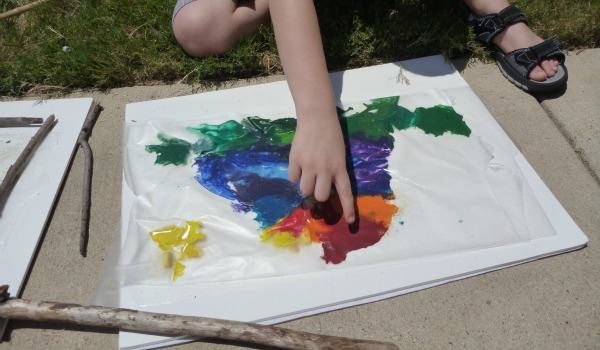 boy pointing to art work