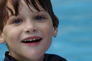 Boy age 5 smiling