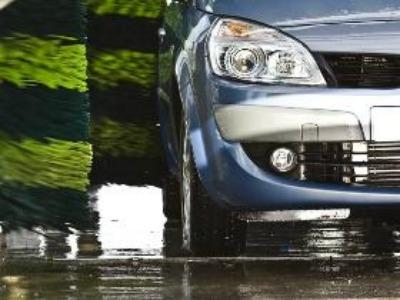shiny silver car washed at speedy bee car wash