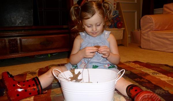 girl playing with sensory tub