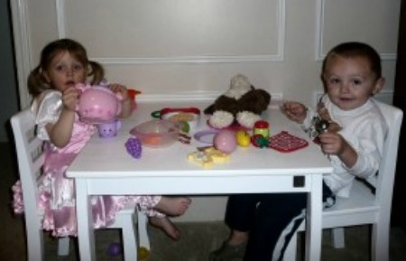 2 children tea party at table