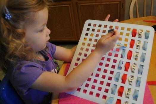 girl working on lacing card