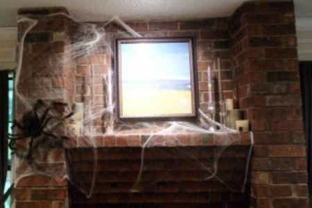 halloween spider webs on fireplace