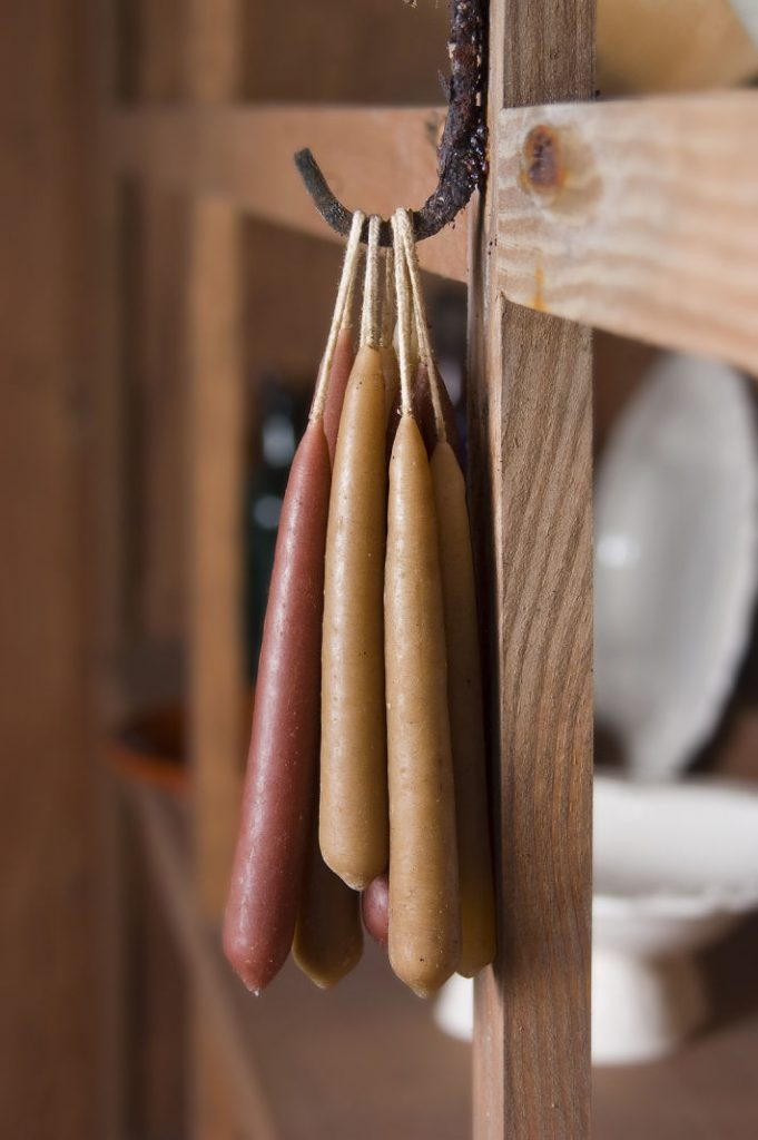 Homemade Dipped Candles hanging on a hook