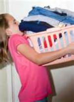 little girl with laundry basket