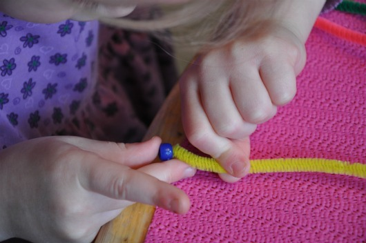 stringing beads on pipe cleaner