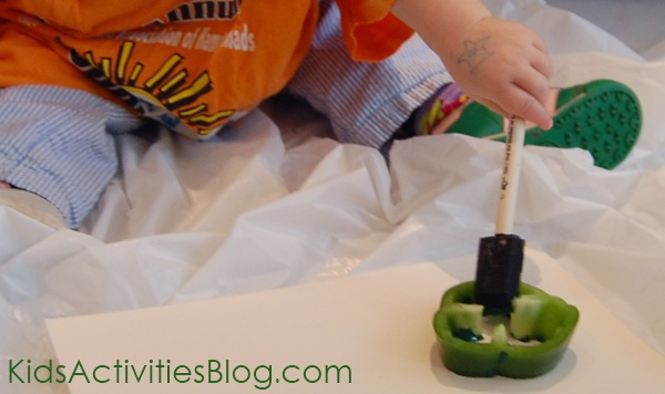 Kid painting veggies