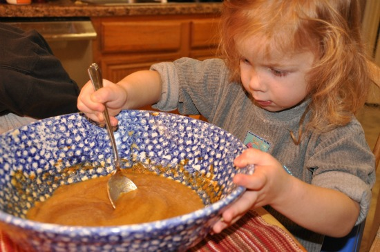 little girl with mixing bowl