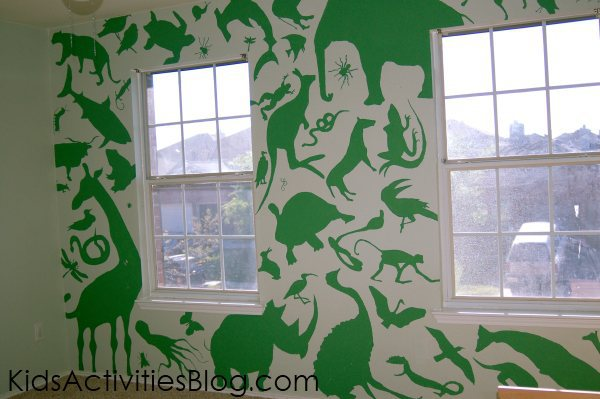 animal mural for boys bedroom using animal shapes painted with green paint