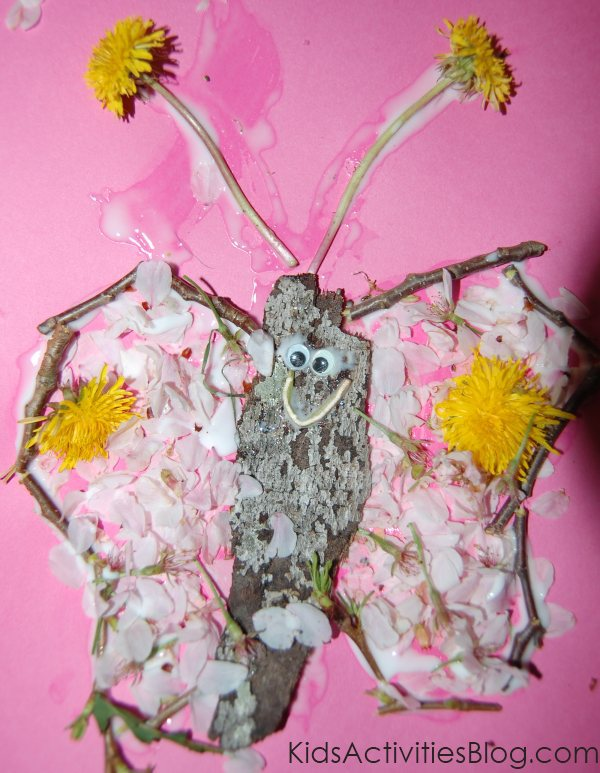 butterfly collage made from flower petals, dandelions, twigs, and bark.
