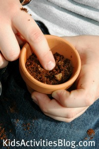child planting seed