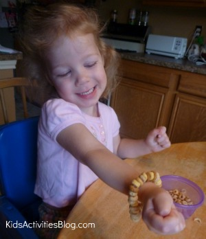 girl with cheerios bracelet