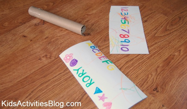 child drawing and paper towel roll