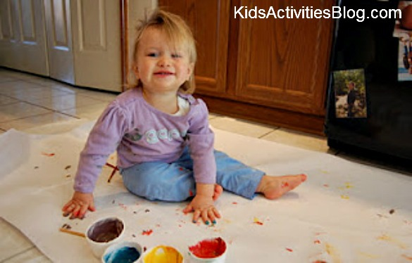 little girl fingerpainting