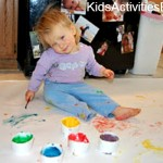 little girl painting on floor