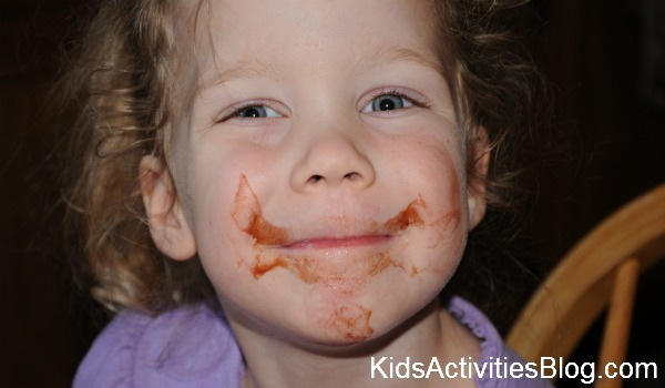 little girl with chocolate on her face