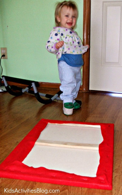 little girl with diy felt board