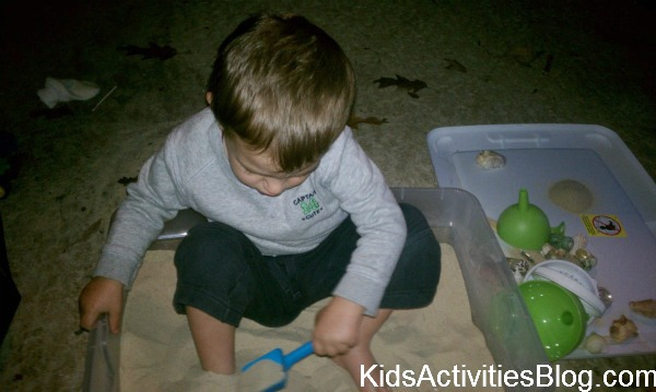 boy in box of sand