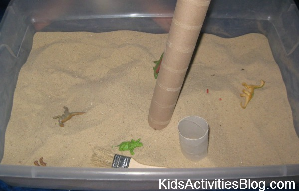 dinosaurs in sand box