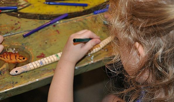 girl coloring snake