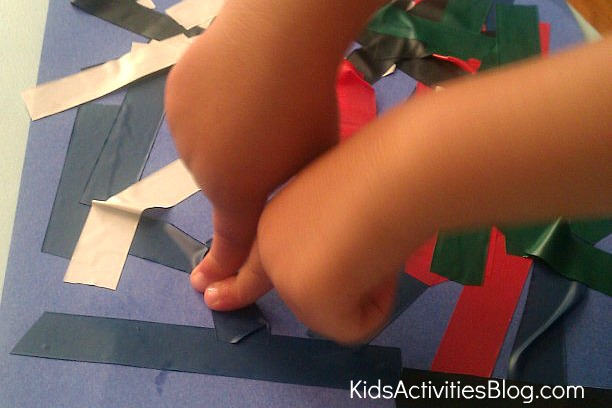 child making tape art