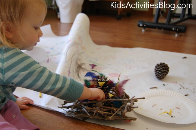 little girl making bird nests